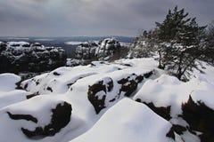 Before Sunrise in a beautiful mountain landscape of Czech-Saxony Switzerland. Winter in the Czech landscape. Snow in the rock. Mor Stock Photo