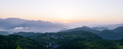 Sunrise at beautiful rice terrace fields in Mingao. Sunrise at ethnic village among highlands and mountains of southeastern China. Fields of rice terraces royalty free stock images
