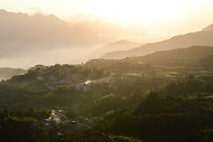Sunrise at beautiful rice terrace fields in Mingao. Sunrise at ethnic village among highlands and mountains of southeastern China. Fields of rice terraces stock photography