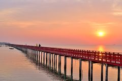 Sunrise and beautiful sky background at wooden red bridge over t royalty free stock images