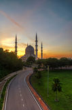Sunrise at The beautiful Sultan Salahuddin Abdul Aziz Shah Mosque, Shah Alam. Royalty Free Stock Image