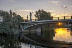Sunrise behind a bridge. Sun is rising behind a bridge Royalty Free Stock Photography