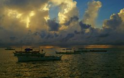 Sunrise behind the clouds. Dramatic sunrise over the Pacific Ocean on the island of Siargao, Philippines Stock Photos