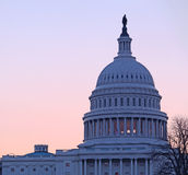 Sunrise behind the dome of the Capitol in DC Stock Images