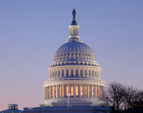 Sunrise behind the dome of the Capitol in DC Royalty Free Stock Photo
