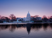 Sunrise behind the dome of the Capitol in DC Stock Photo