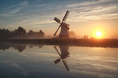 Sunrise behind Dutch windmill Stock Photo
