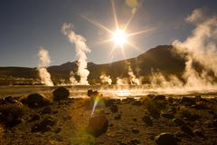 El Tatio Geysers. Sunrise behind fumaroles at an altitude of 4300m, El Tatio Geysers, Atacama desert, Antofagasta Region, Chile, South America Stock Images