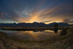 Morning Sky Behind The Montana Mountains. Sunrise behind the Montana Mountains with beautiful reflection in the lake Royalty Free Stock Photos