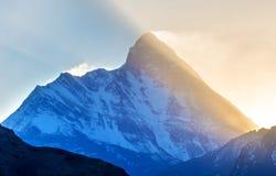 Sunrise behind mountain Stock Images