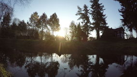 Sunrise behind the pond in old farm, time lapse 4K stock video footage