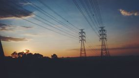 Sunrise with energy tower stock photography