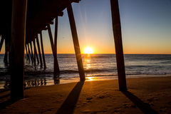 Sunrise Beneath the Pier Royalty Free Stock Photos