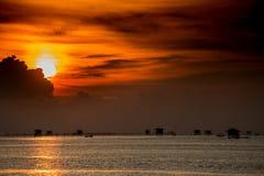 Sunrise beyond the fisherman village. Royalty Free Stock Photo