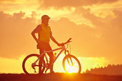 Sunrise with biker Stock Image