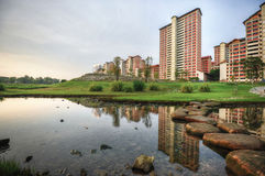 Sunrise at Bishan Park. Warm sunrise against high rise apartments Royalty Free Stock Images