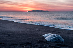 Sunrise. In black beach in Santorini Stock Photo