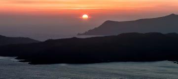 Sunrise. In black beach in Santorini Royalty Free Stock Images