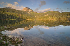 Sunrise at Black Lake, Durmitor National Park. Sunrise over the Black Lake in Durmitor National Park in northern Montenegro Royalty Free Stock Photo