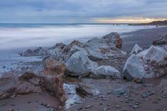 Sunrise on black sand volcanic beach. Tenerife Royalty Free Stock Photo