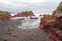Sunrise on black sand volcanic beach. Tenerife Stock Photography