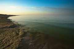 Sunrise on Black Sea. Sunrise on sea with part of sand beach. Black Sea, Russia stock photography