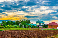 Sunrise,Blue sky with clouds over the rural villages in thailand Stock Photos