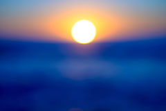 Sunrise blur. Blur of sunrise over water Stock Photography