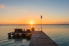 Sunrise on the boardwalk in Bacalar, Mexico Stock Image