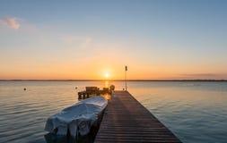 Sunrise on the boardwalk in Bacalar, Mexico. Colorful sunrise on the boardwalk in Bacalar, Mexico Stock Photos