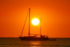 Sunrise and boat stock photography