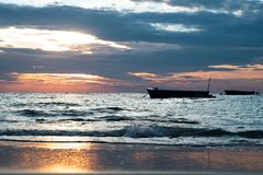 Sunrise and boat at Sangtian Beach Samet island Rayong Thailand. Sunrise and boat at Sangtian Beach ,Samet island, Rayong Thailand . background stock photo