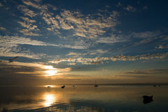 Sunrise with boats Royalty Free Stock Photos