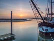 Sunrise with Boats in Harbour Royalty Free Stock Images