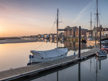 Sunrise with Boats in Harbour Royalty Free Stock Photography