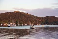 Sunrise and boats in the harbour of Mangonui, New Zealand Royalty Free Stock Photography