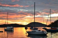Sunrise and boats on the sea. Ubatuba, Brazil stock photography