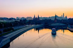 Sunrise at Bolshoy Moskvoretsky Bridge at Kremlin of Moscow. City in Russia in the morning stock photography