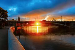 Sunrise at Bolshoy Moskvoretsky Bridge and Kremlin of Moscow. City in Russia in the morning royalty free stock photo