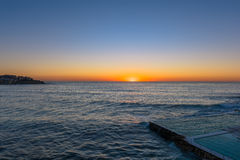 Sunrise on the Bondi Beach Sydney NSW Australia. Bondi Beach  is a popular beach and the name of the surrounding suburb in Sydney, New South Wales, Australia Stock Images