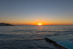 Sunrise on the Bondi Beach Sydney NSW Australia. Bondi Beach  is a popular beach and the name of the surrounding suburb in Sydney, New South Wales, Australia Stock Photo