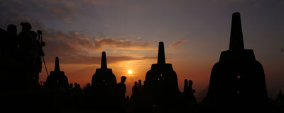Sunrise from Borobudur Template. The Borobudur Temple in Indonesia has the most breathtaking sunrise view. The temple structure and statues are one of a kind stock photo