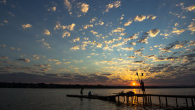 Sunrise in Brasilia. Sunrise showing a lake and wooden bridge with beautiful colors and a rowing with crossing oars Stock Photos