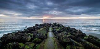 Sunrise on Bray,Ireland. Sunrise off rocky coast of along waterfront in Bray, Ireland Stock Image