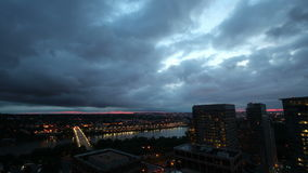 Sunrise breaking over city time lapse stock footage