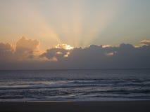 Sunrise breaks through the Cloud. S over the Ocean royalty free stock photos