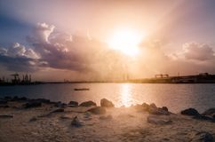 Sunrise in a breakwater Royalty Free Stock Photos