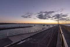 Breakwater sunrise calm Stock Image