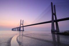Sunrise and bridge over Tagus river in Lisbon Portugal. Image of Vasco da Gama bridge over Tagus river in Lisbon Portugal before sunrise Stock Images