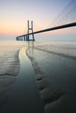 Sunrise and bridge over Tagus river in Lisbon Portugal Royalty Free Stock Photos